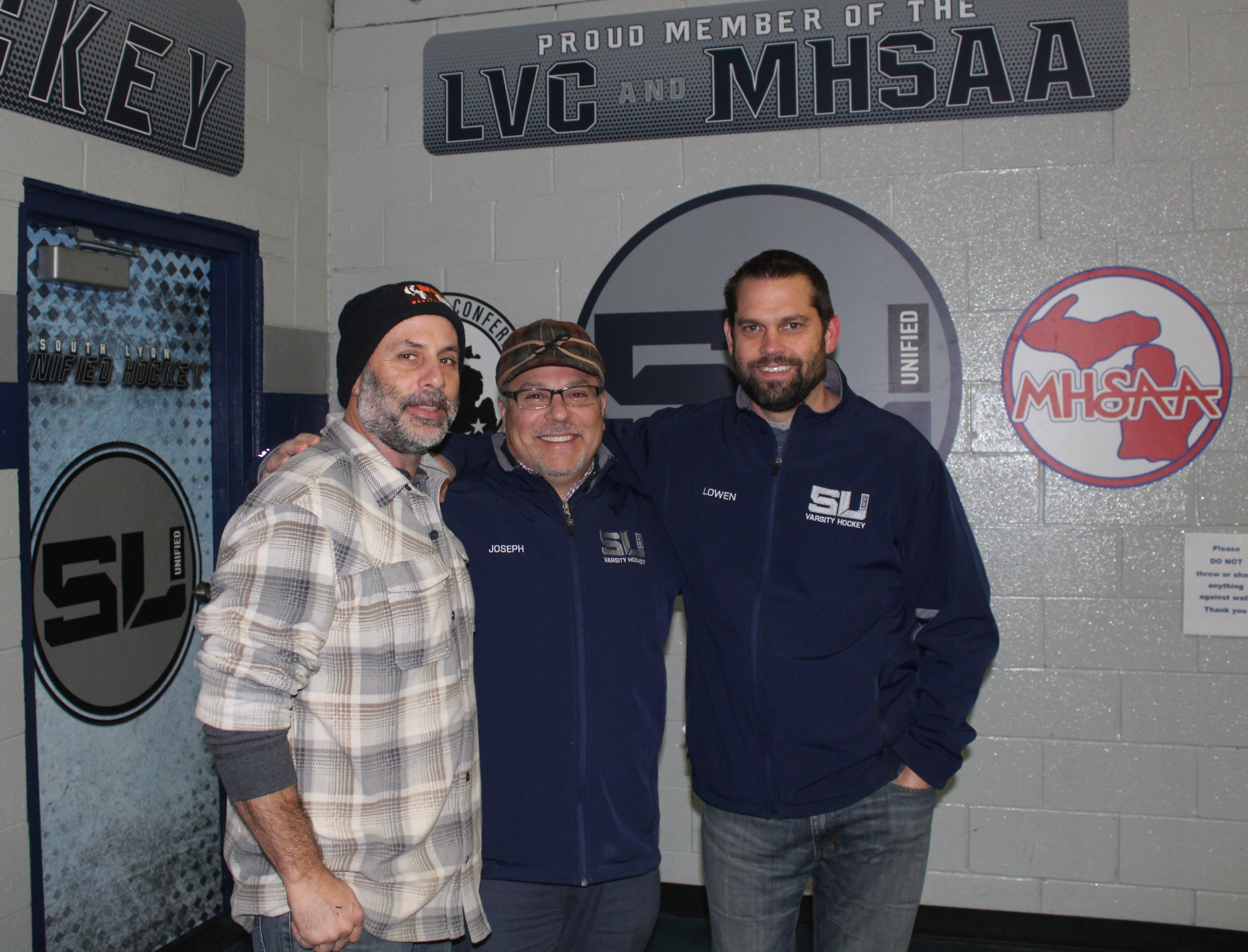 South Lyon Unified boosters' core trio of (left to right) Darin Dudek, Mike Joseph and Scott Lowen were the key players in getting the team's locker room renovation project off the ground.