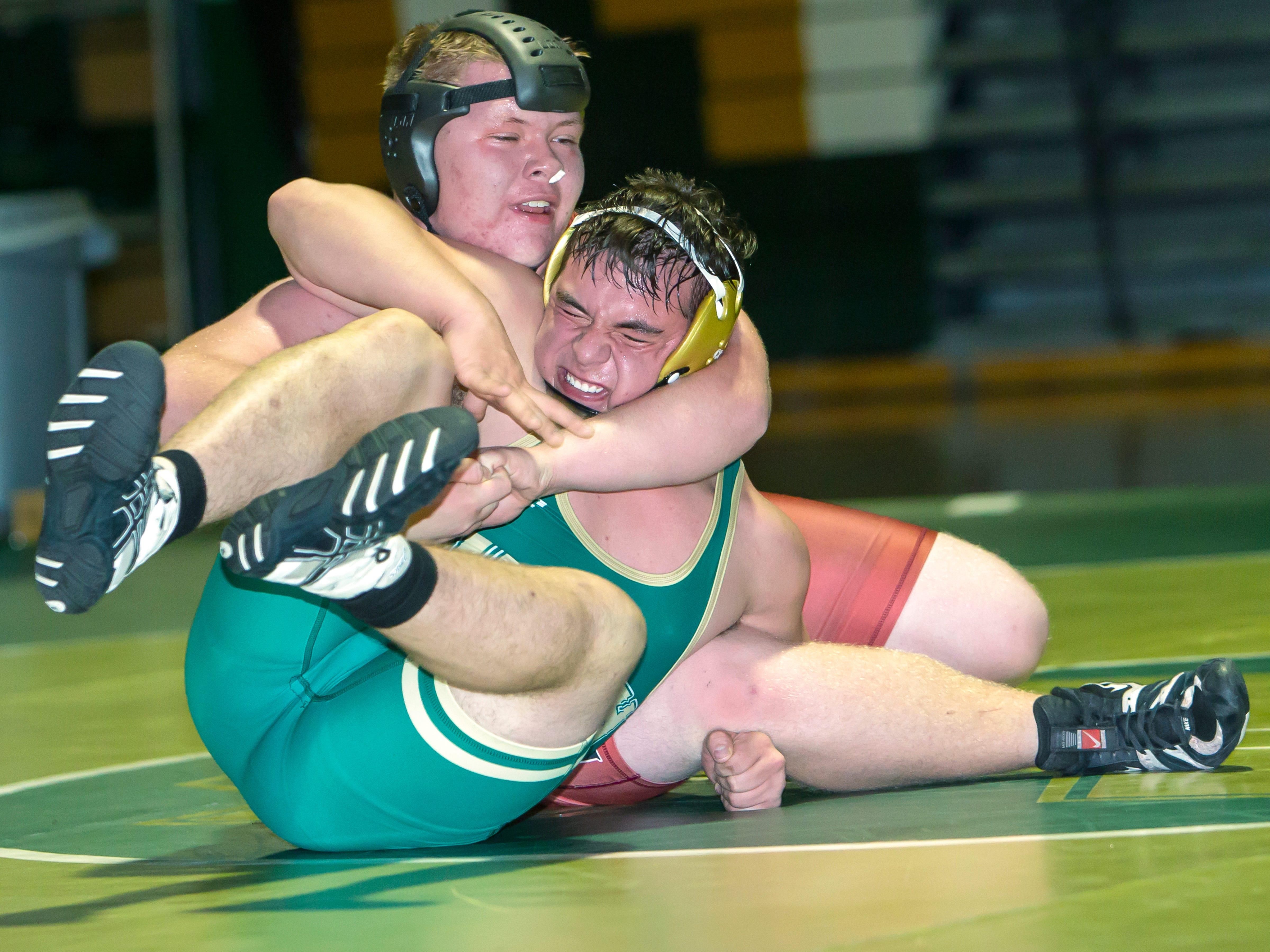 Oshkosh North's AJ Besaw wrestles Fond du Lac's Joey Schmitz in the 285 weight class at Oshkosh North High School on Thursday, November 29, 2018.