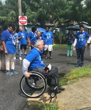 David Mayo, a candidate for Pensacola mayor, demonstrates how a curb on DeVilliers Street is not wheelchair accessible on July 26, 2018.