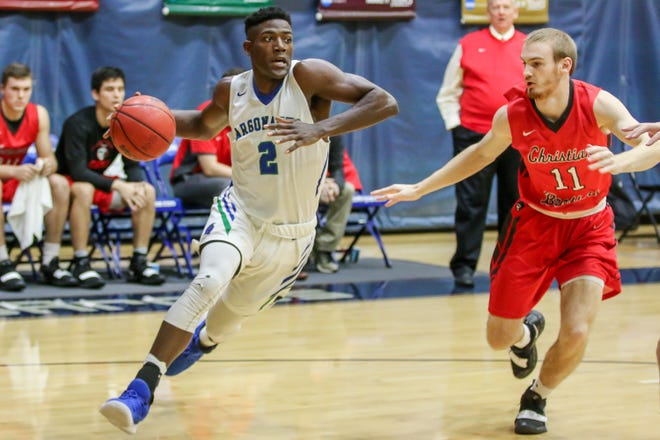 UWF's Jon Brown (2) drives past Christian Brothers' Joe Laravie (11) on his way to the basket in a Gulf South Conference game at the University of West Florida on Thursday, November 29, 2018.