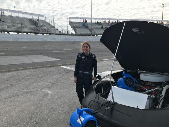 Johanna Robbins with her race car following practice Friday at Five Flags Speedway for Saturday's Allen Turner Snowflake 100