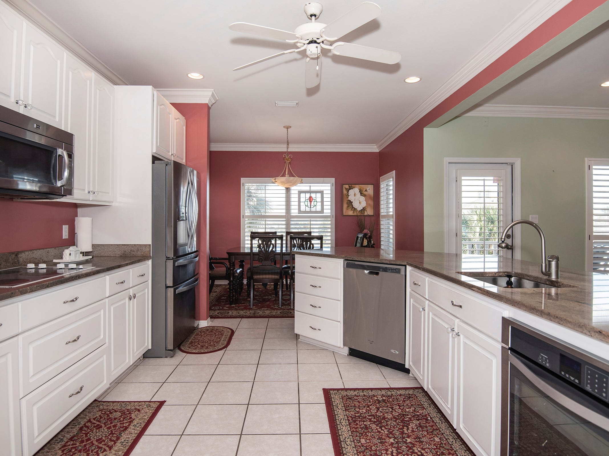 1 La Caribe Dr.The kitchen is open to the living and dining space.
