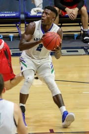 UWF's Jon Brown (2) makes a quick stop and takes a shot against Christian Brothers in a Gulf South Conference game at the University of West Florida on Thursday, November 29, 2018.