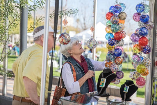Browsing the booths at the Mesa Arts Festival.