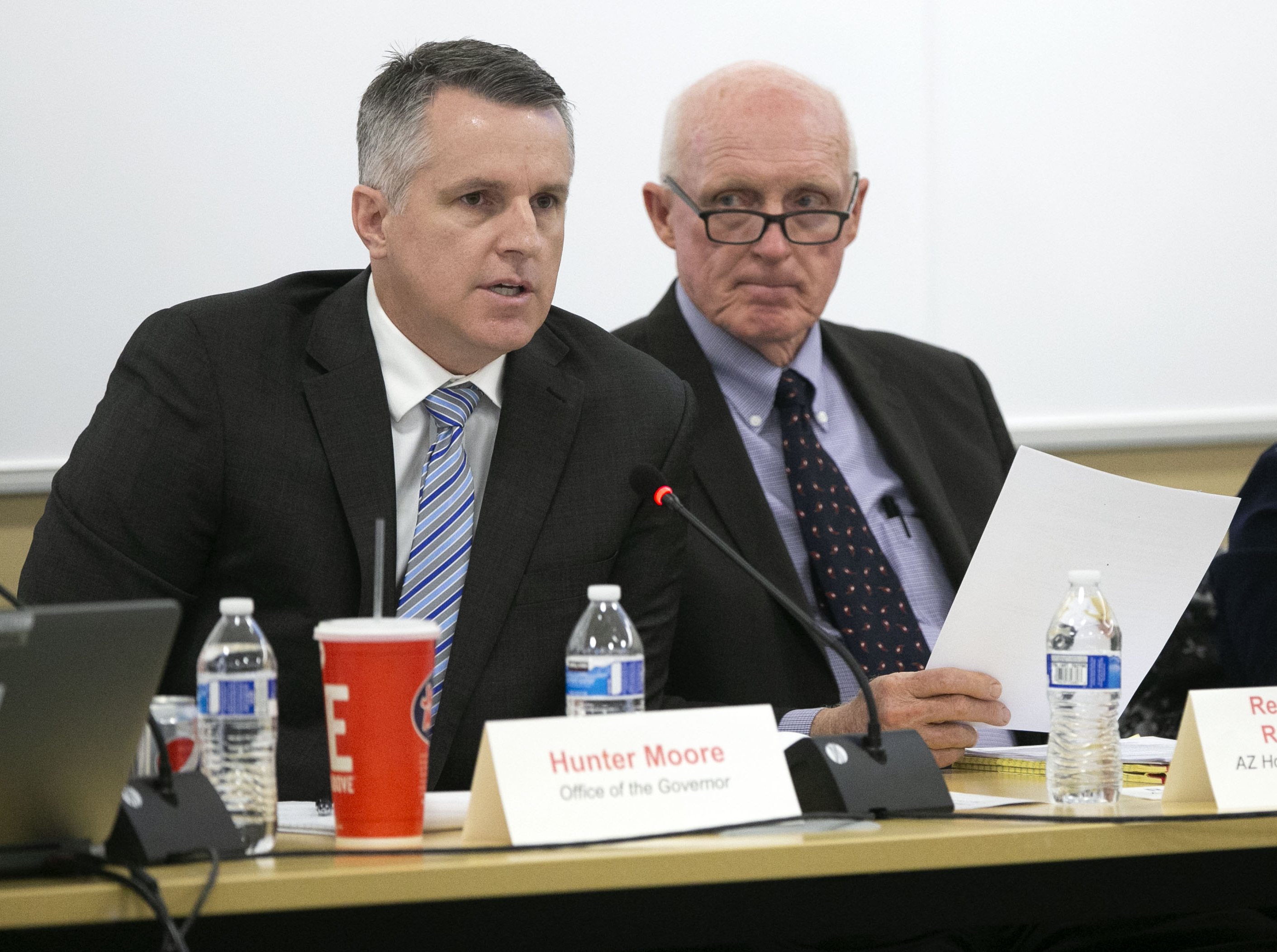 Hunter Moore, (left) of the Office of the Governor, speaks as Rep. Rusty Bowers, Arizona House Of Representatives District #25, listens during the Arizona Lower Basin Drought Contingency Plan Steering Committee meeting to work on a drought contingency plan for the Colorado River at Central Arizona Project headquarters in Phoenix on November 29, 2018.