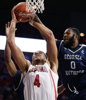 Arizona Wildcats center Chase Jeter (4) is fouled by Georgia Southern Eagles forward Montae Glenn (0) during the first half of the University of Arizona Wildcats vs. Georgia Southern University men's college basketball game Nov. 29, 2018, at McKale Center in Tucson, Ariz.