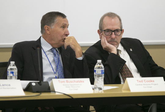 Tom Buschatzke, (left) the Director of the Arizona Department of Water Resources and Ted Cooke, General Manager of the Central Arizona Project, converse during the Arizona Lower Basin Drought Contingency Plan Steering Committee meeting to work on a drought contingency plan for the Colorado River at Central Arizona Project headquarters in Phoenix on November 29, 2018.