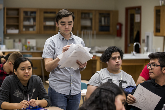 Caillou Peña hands back tests to Robin Andrews' chemistry class on Nov. 20, 2018, at Skyline High School in Mesa. Peña is a Chief Science Officer and advocates for STEM subjects at his school.