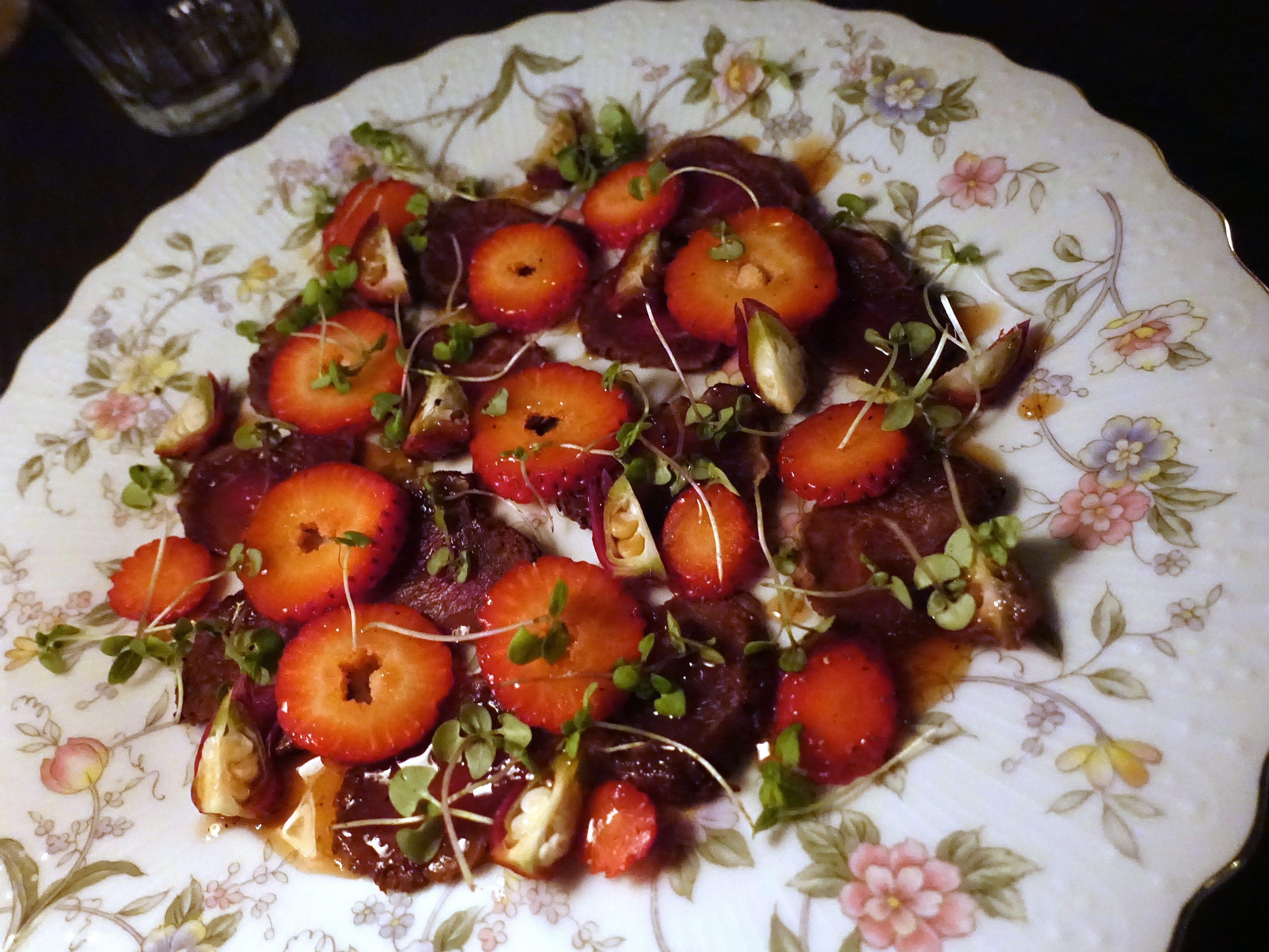 Cabrito tenderloin carpaccio with roselle hips, strawberries and mesquite at Cotton & Copper in Tempe.