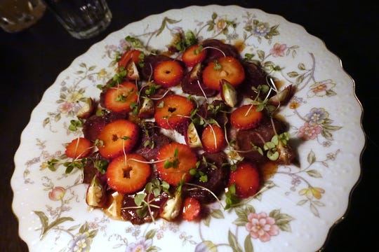 Cabrito tenderloin carpaccio with roselle hips, strawberries and mesquite at Cotton & Copper in Tempe.