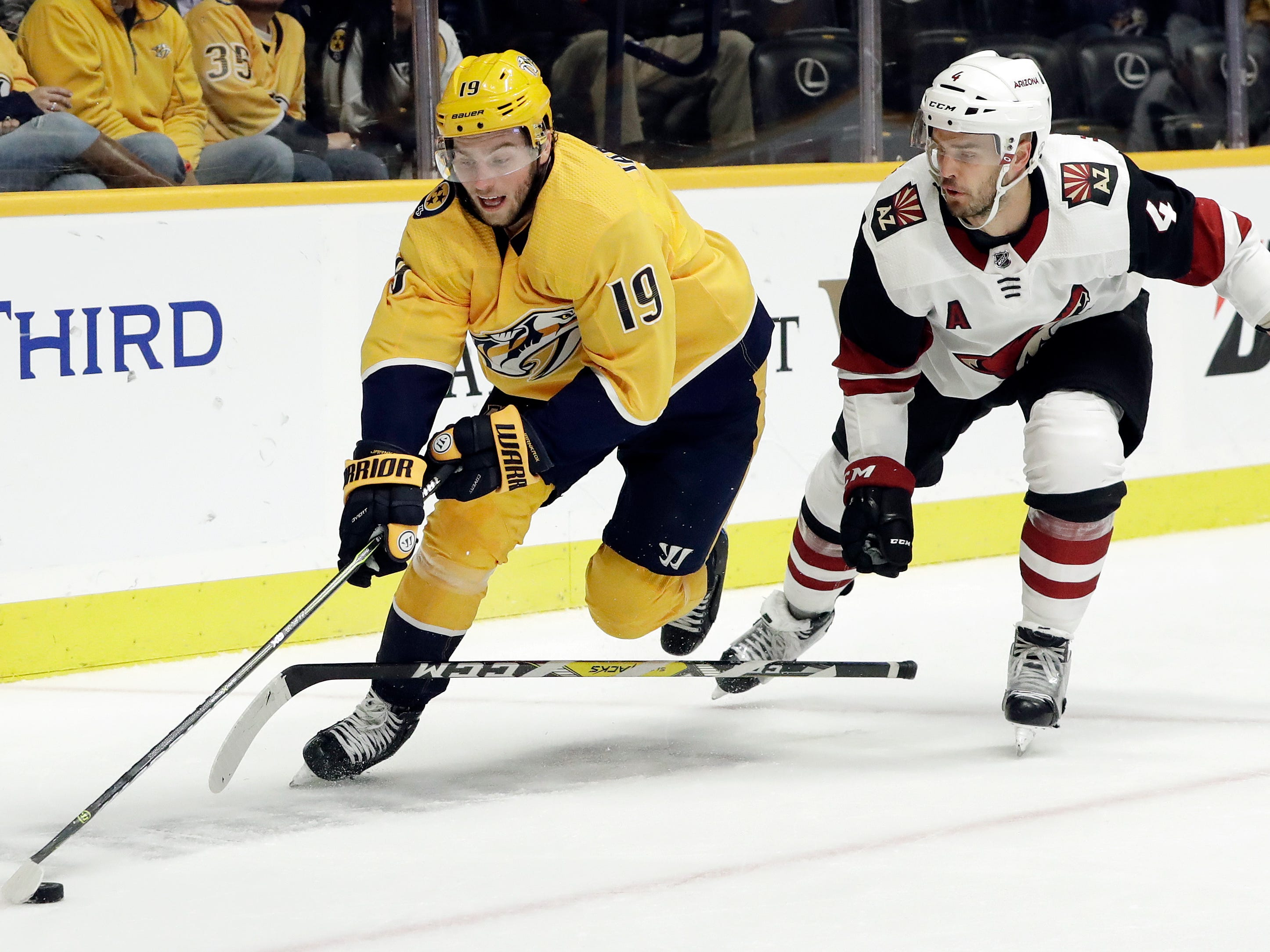 Arizona Coyotes defenseman Niklas Hjalmarsson (4), of Sweden, loses his stick as Nashville Predators center Calle Jarnkrok (19), also of Sweden, takes the puck away in the second period of an NHL hockey game Thursday, Nov. 29, 2018, in Nashville, Tenn. (AP Photo/Mark Humphrey)