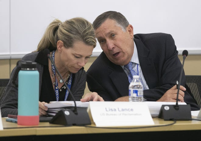 Lisa Lance (left) of the U.S. Bureau of Reclamation and Tom Buschatzke, the Director of the Arizona Department of Water Resources, converse during the Arizona Lower Basin Drought Contingency Plan Steering Committee meeting to work on a drought contingency plan for the Colorado River at Central Arizona Project headquarters in Phoenix on November 29, 2018.