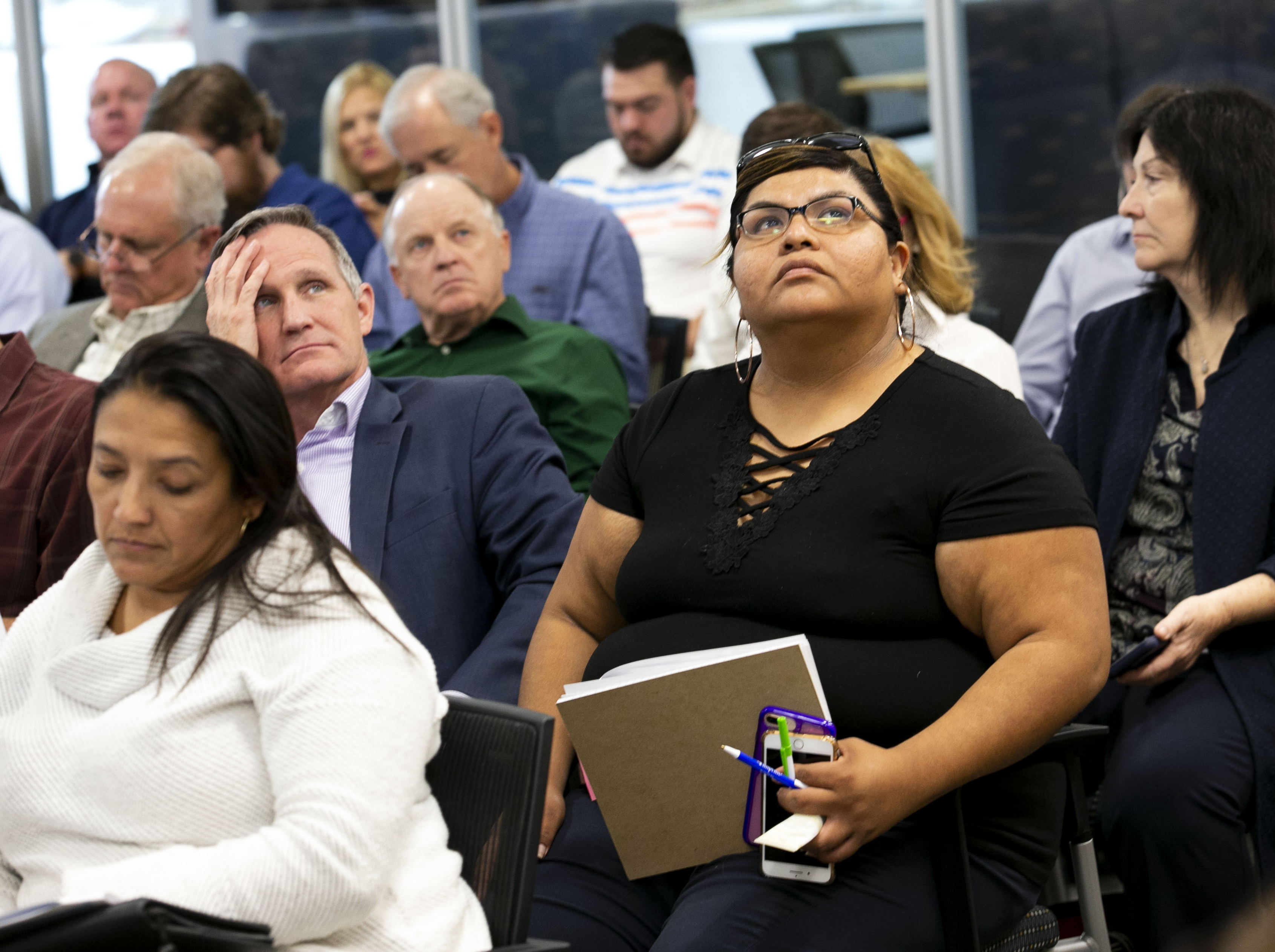 Mitzi Galvez (center right) of the San Xavier Allottees Association, listens from the audience during the Arizona Lower Basin Drought Contingency Plan Steering Committee meeting to work on a drought contingency plan for the Colorado River at Central Arizona Project headquarters in Phoenix on November 29, 2018.