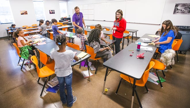 Teachers Kelsey Herrmann and Anthony Carter teach their second-grade engineering class together at Basis Phoenix South Primary school.