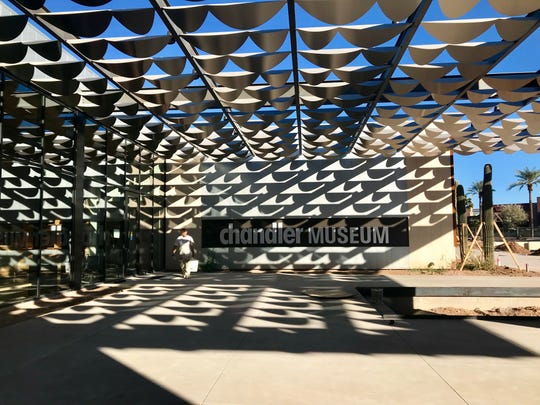 """Infinite Shade"" by artist Jeff Zischke is a functional art installation at the entrance of the new Chandler Museum facility, made up of 202 stainless steel fins."