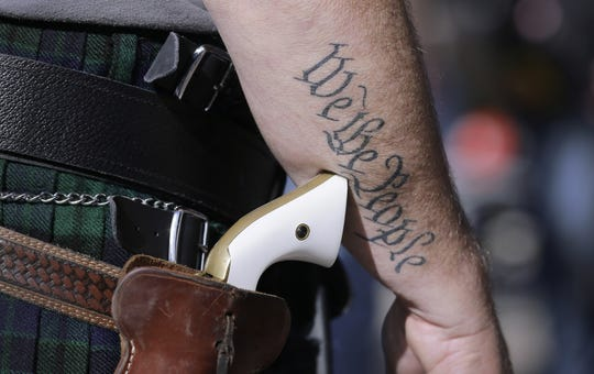 Eric Gay, AP Scott Smith, a supporter of open carry gun laws, wears a pistol as he prepares for a rally at the Capitol, Monday, Jan. 26, 2015, in Austin, Texas. (AP Photo/Eric Gay) ORG XMIT: TXEG102