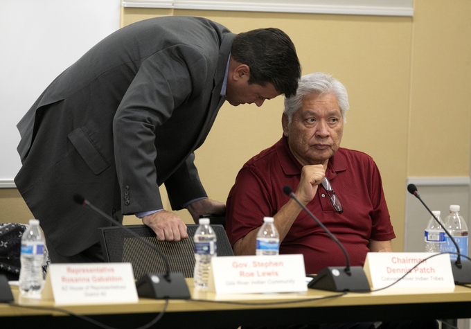 Tom Farley, (left) a lobbyist with Colorado River Indian Tribes speaks to Chairman Dennis Patch of the Colorado River Indian Tribes, during a break in the middle of the Arizona Lower Basin Drought Contingency Plan Steering Committee meeting to work on a drought contingency plan for the Colorado River at Central Arizona Project headquarters in Phoenix on November 29, 2018.