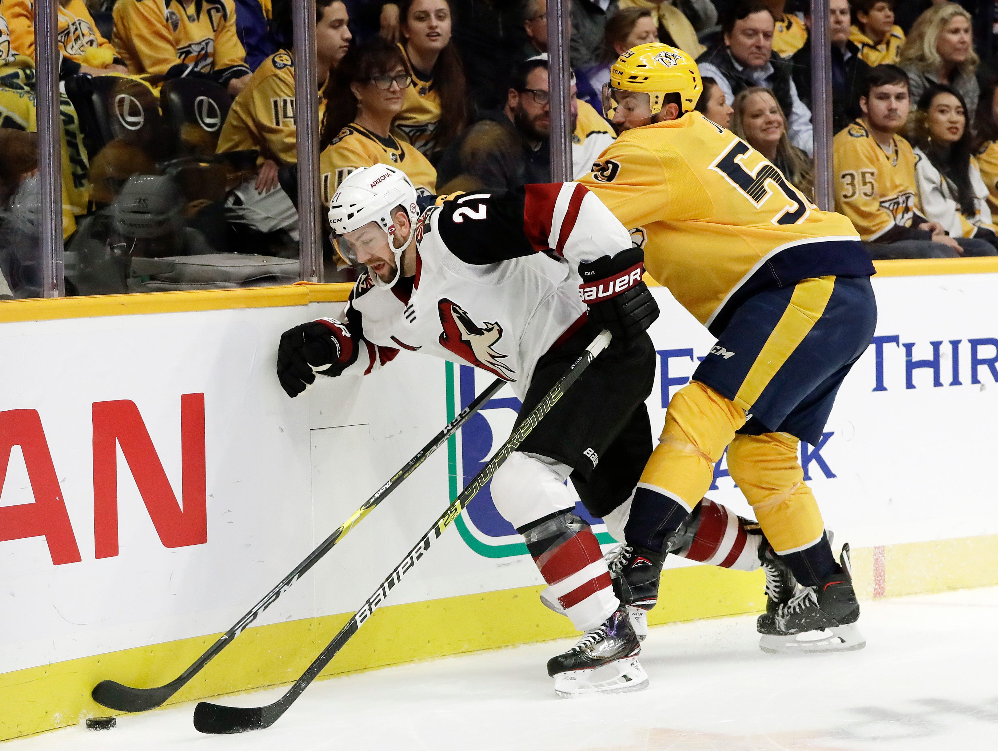 Arizona Coyotes center Derek Stepan (21) and Nashville Predators defenseman Roman Josi (59), of Switzerland, chase down the puck during the first period of an NHL hockey game Thursday, Nov. 29, 2018, in Nashville, Tenn. (AP Photo/Mark Humphrey)