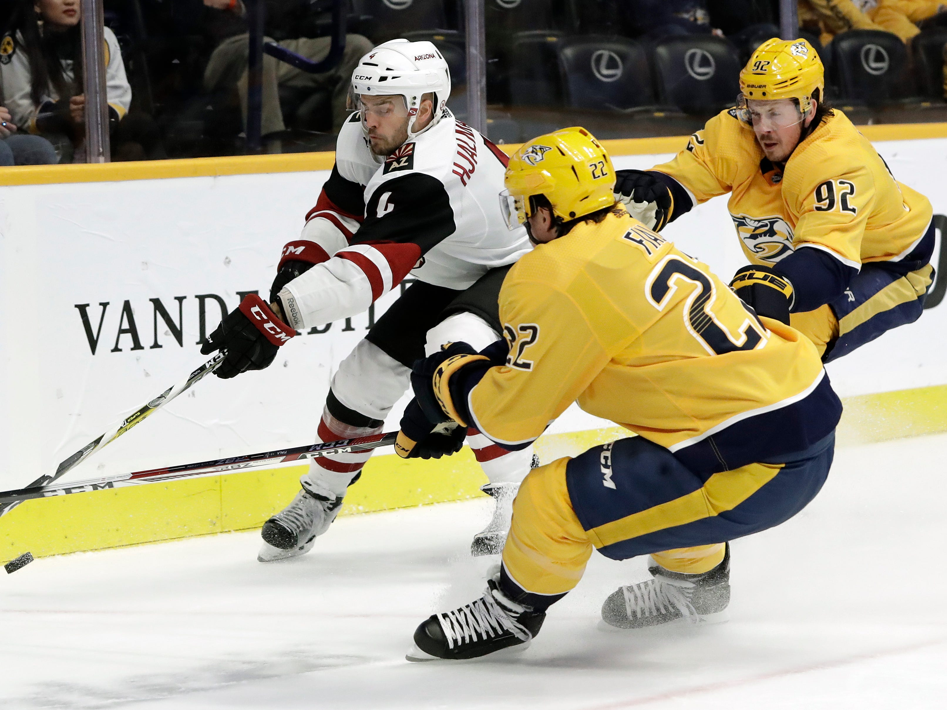 Arizona Coyotes defenseman Niklas Hjalmarsson (4), of Sweden, chases after the puck with Nashville Predators left wing Kevin Fiala (22), of Switzerland, and center Ryan Johansen (92) in the second period of an NHL hockey game Thursday, Nov. 29, 2018, in Nashville, Tenn. (AP Photo/Mark Humphrey)