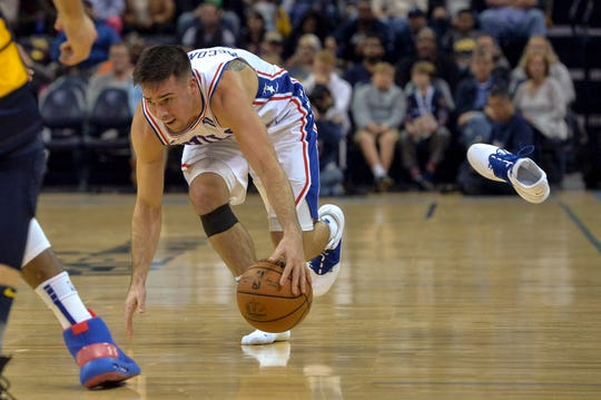 T.J. McConnell of the 76ers loses a shoe while dribbling the ball during the first half of a game against the Grizzlies on Nov. 10.