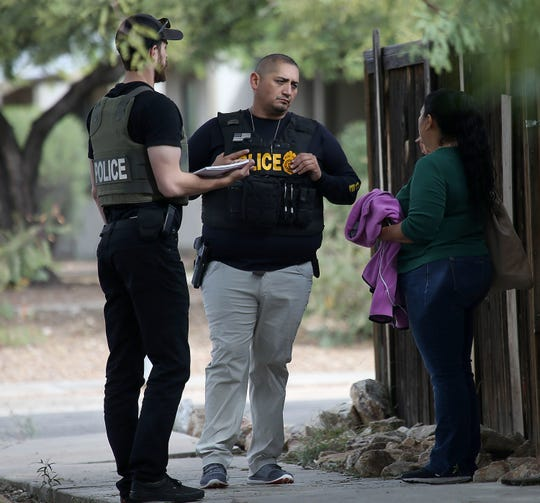 Law-enforcement personnel talk with residents Nov. 30, 2018, in the neighborhood where Deputy U.S. Marshal Chase White was serving a felony arrest warrant when he was shot and killed Nov. 29 outside a north Tucson house.