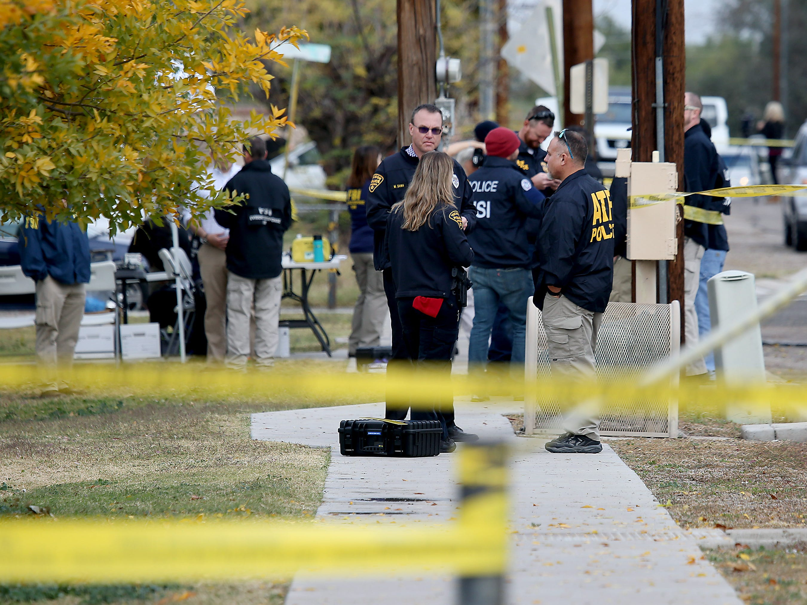 Law-enforcement personnel continue their investigation Nov. 30, 2018, at the scene where Deputy U.S. Marshal Chase White was serving a felony arrest warrant when he was shot and killed Nov. 29 outside a north Tucson house.