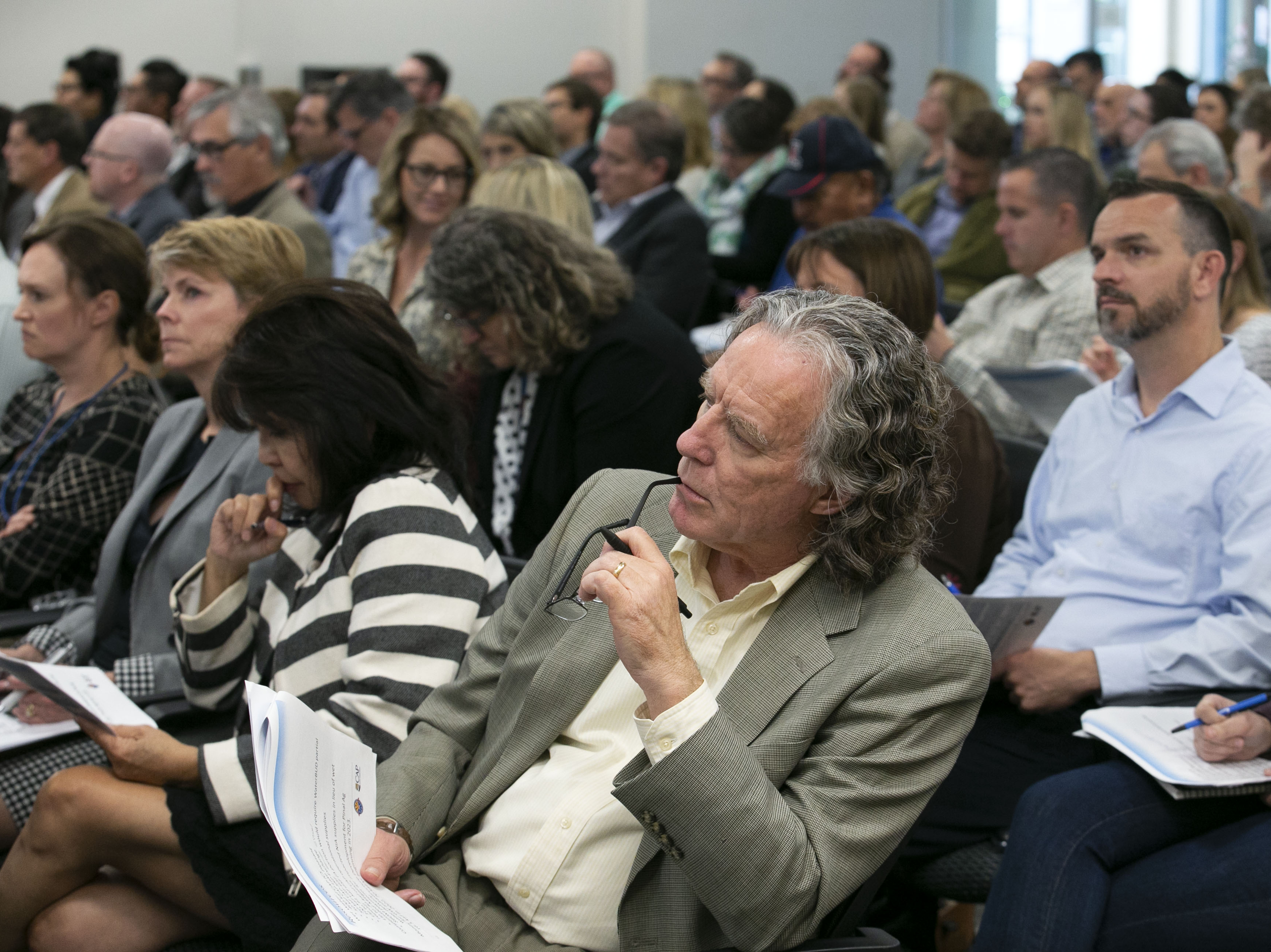 Kip Volpe, co-chair of the Tucson Regional Water Coalition of the Southern Arizona Leadership Committee, listens from the audience during the Arizona Lower Basin Drought Contingency Plan Steering Committee meeting to work on a drought contingency plan for the Colorado River at Central Arizona Project headquarters in Phoenix on November 29, 2018.