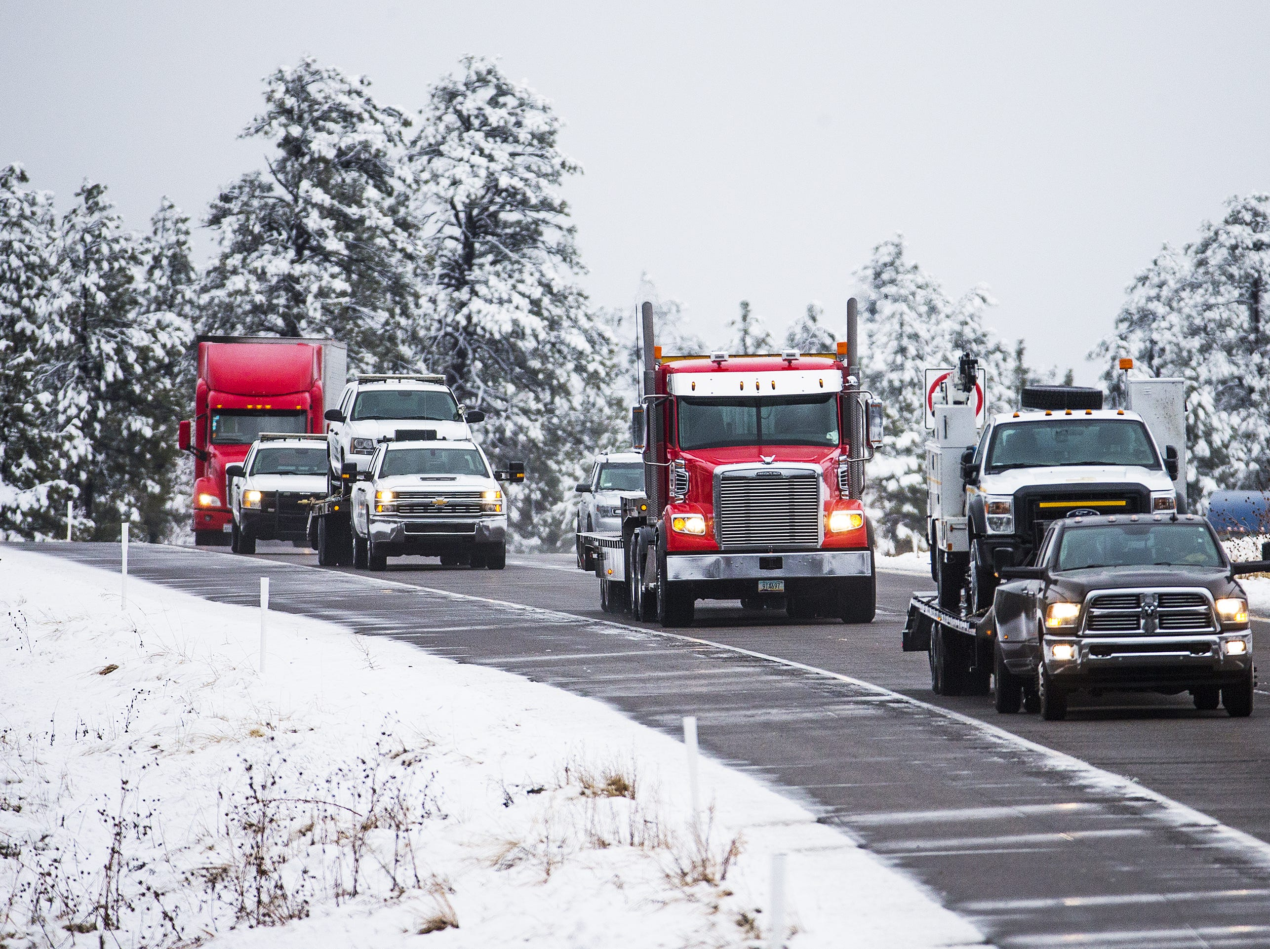 Traffic makes its way south on I-17, 1 mile north of Fox Ranch Road, south of Flagstaff on November 30, 2018. Snow has fallen in northern Arizona causing dangerous driving conditions that have resulted in cars and trucks sliding off the road.