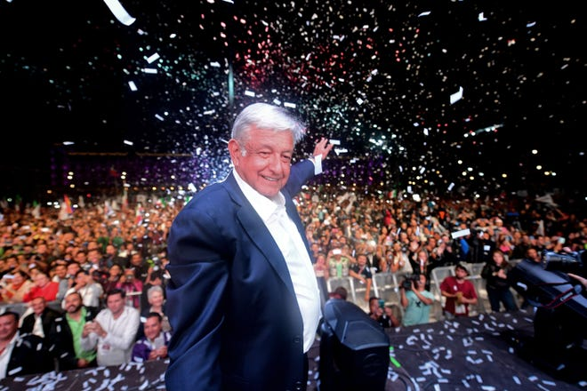 "Newly elected Mexico's President Andres Manuel Lopez Obrador (C), running for ""Juntos haremos historia"" party, cheers his supporters at the Zocalo Square after winning general elections, in Mexico City, on July 1, 2018. (Photo by PEDRO PARDO / AFP)        (Photo credit should read PEDRO PARDO/AFP/Getty Images)"