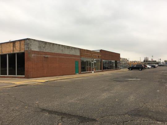 Both the north and south ends of the strip mall in the 2800 block of Pine Grove Avenue in Port Huron have empty storefronts. The complex's owners initiated construction on its facade in November 2018.
