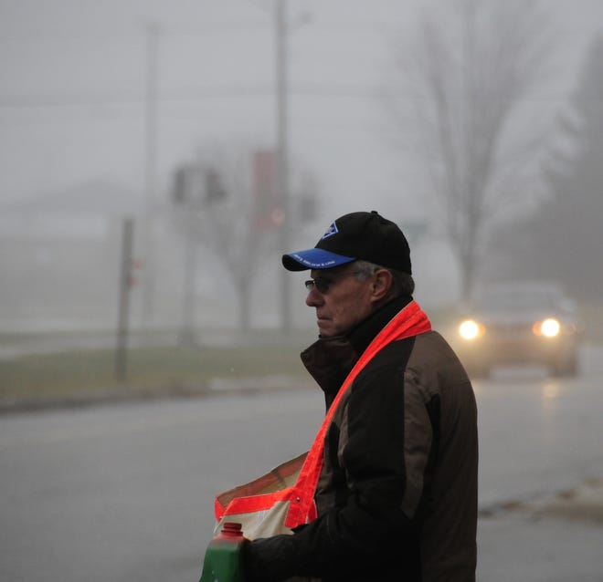 Wayne Steinhaus sells the Times Herald for the Old Newsboys outside the U.S. Postal Service Office in Marysville on Friday, Nov. 30, 2018.