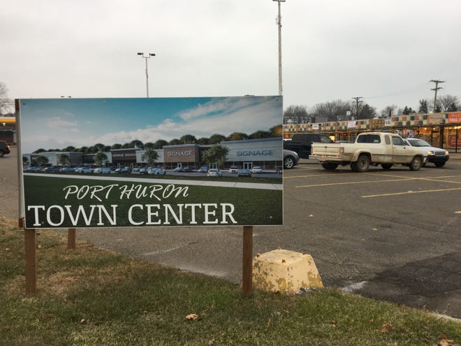 A rendering of renovation plans for the Port Huron Town Center is show along Pine Grove Avenue with the complex, now under construction, behind it on Thursday, Nov. 29, 2018.
