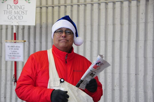 Old Newsboys volunteer Len Montoya hawks copies of the Times Herald outside Vinckier Foods in Wadhams on Friday, Nov. 30, 2018.
