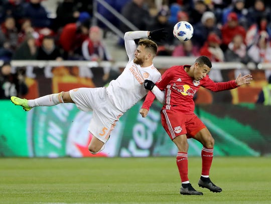 New York Red Bulls' Tyler Adams, right, and Atlanta United FC's Leandro Gonzalez go for the ball on Thursday at Red Bull Arena in Harrison, New Jersey.