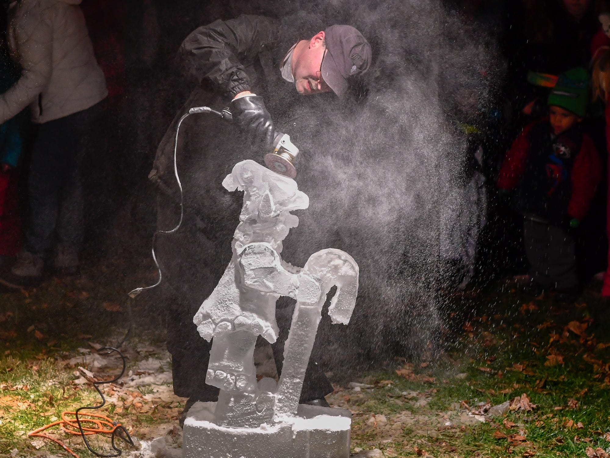 Bruce Keefer of Hanover creates a elf ice sculpture during the 3rd annual Christmas tree lighting in Spring Grove, Thursday, November 29, 2018. 