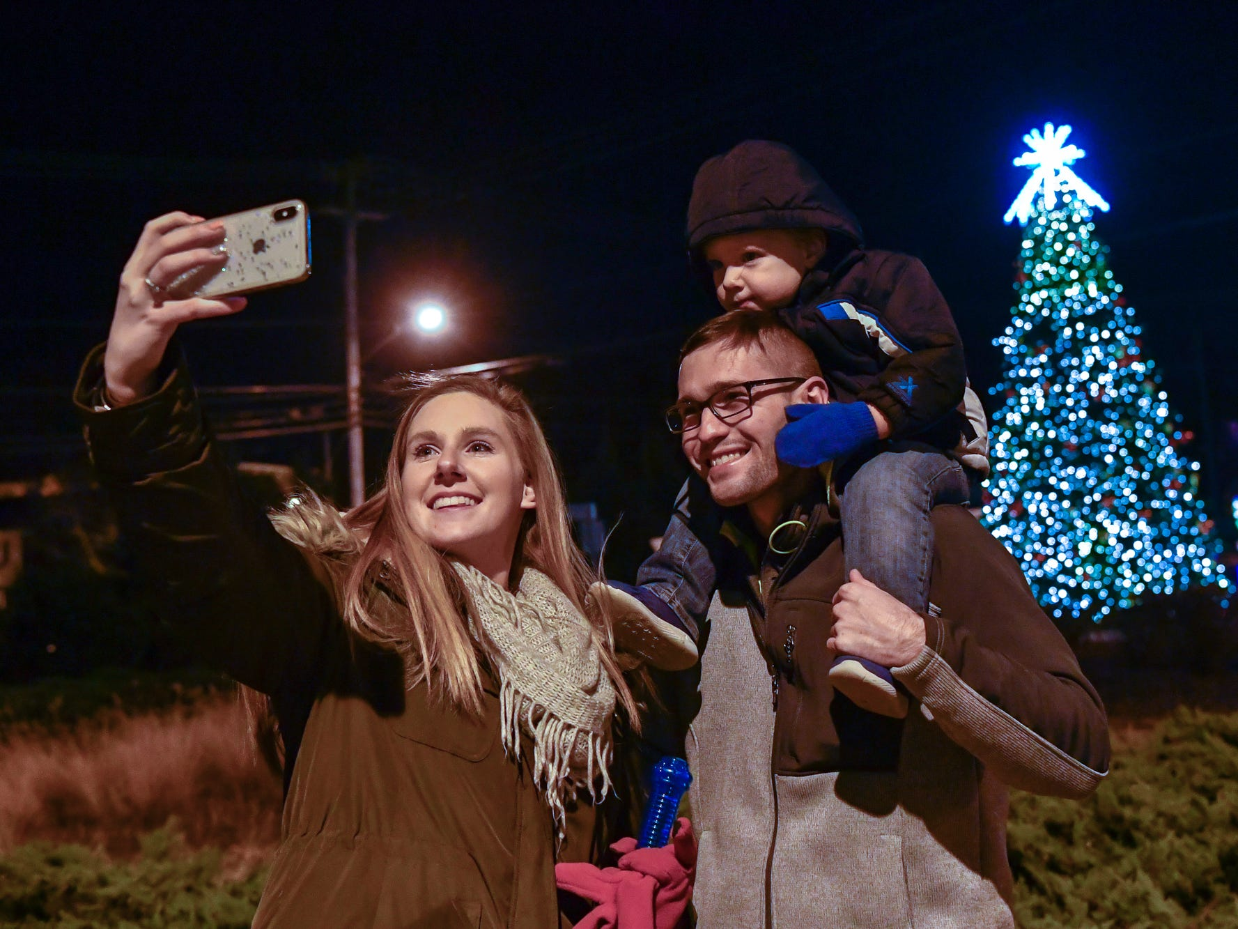 Emily, Tyler and Braylon Williams, 2, of Littlestown, get a family photo during the 3rd annual Christmas tree lighting in Spring Grove, Thursday, November 29, 2018. 