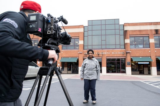 Loretta Claiborne stands in front of the WellSpan Community Health Center Loretta Claiborne Building, on the corner of South George Street and West Boundary Avenue, in York, Friday, Nov. 30, 2018. ESPN and Special Olympics have partnered to do a documentary on 50 athletes to celebrate 50 years of Special Olympics. The documentary on Claiborne will air in Dec. 2018.