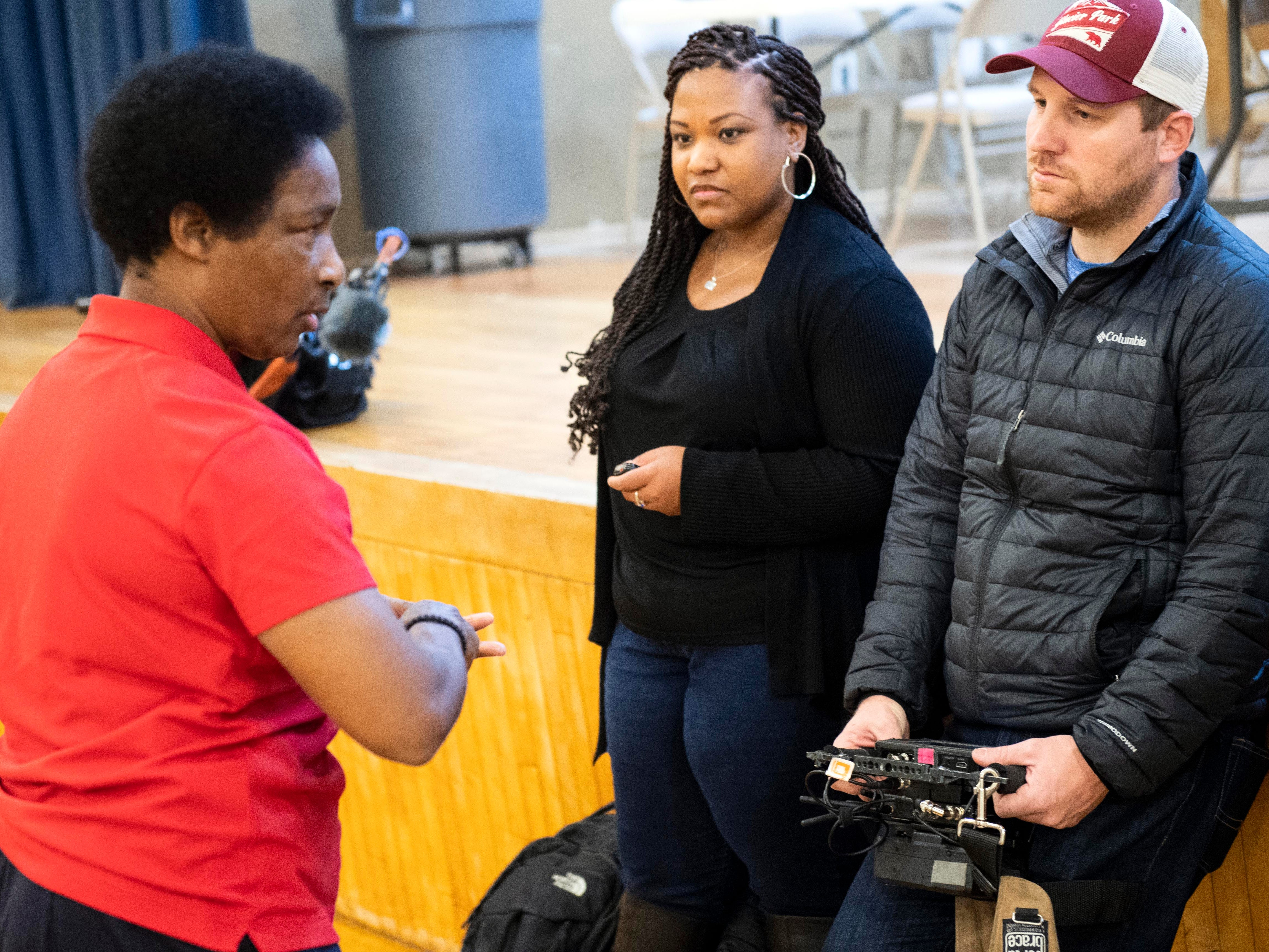 Loretta Claiborne, left, speaks with director Paul Molin, right, after talking to a group of teenagers in the gymnasium of Crispus Attucks in York, Friday, Nov. 30, 2018. ESPN and Special Olympics have partnered to do a documentary on 50 athletes to celebrate 50 years of Special Olympics. The documentary on Claiborne will air in Dec. 2018.