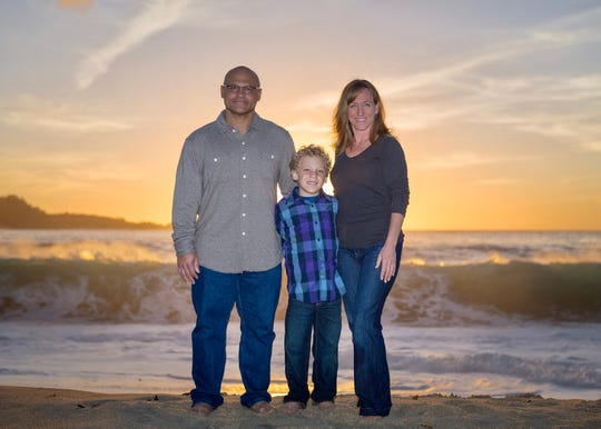 Tracy Smith poses for a photo with his wife, Jen, and son, Xander.