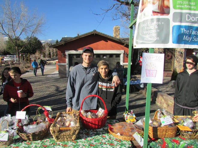 Kienan Herman (left) and Cyrus Moassessi are shown in 2017 at their fundraising coffee stand in South Reno.