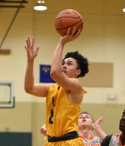 Bishop Manogue's Gabe Bansuelo shoots against Bishop Gorman in the Wild West Shoot Out tournament last year
