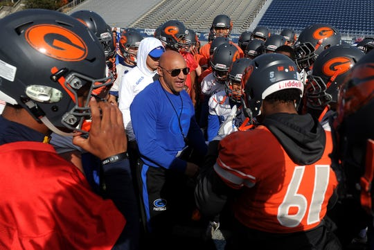 Bishop Gorman head football coach Kenny Sanchez, middle, talks with his players during practice in preparation for the state championship game against Reed at Mackay Stadium in Reno on Dec. 1, 2017.