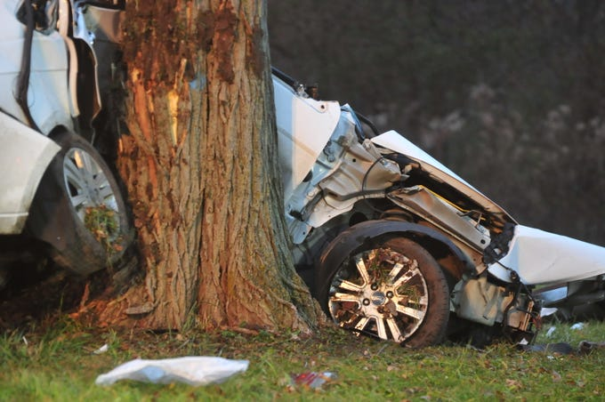 A Ford Focus was partially wrapped around a tree on the south side of National Road West after the driver lost control Friday.