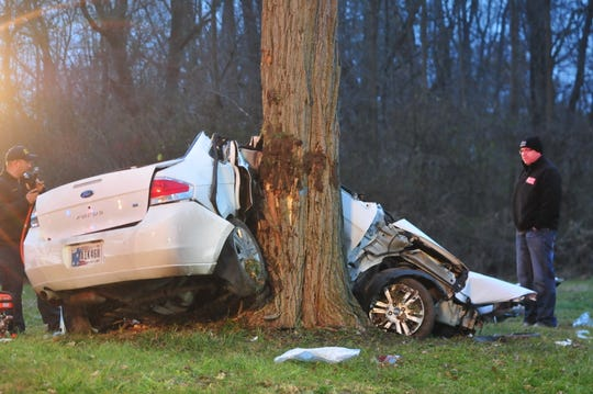 A Ford Focus flew into a tree after the driver lost control while fleeing police Friday on National Road West.
