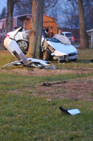 Debris sits in the grass after an accident and extrication Friday on the south side of National Road West.