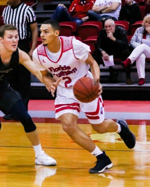 Northeastern High School graduate Tyler Smith moves the ball against Nova Southeastern on Jan. 20, 2018. Smith has transferred from Florida Southern College to University of St. Francis in Fort Wayne, Ind.