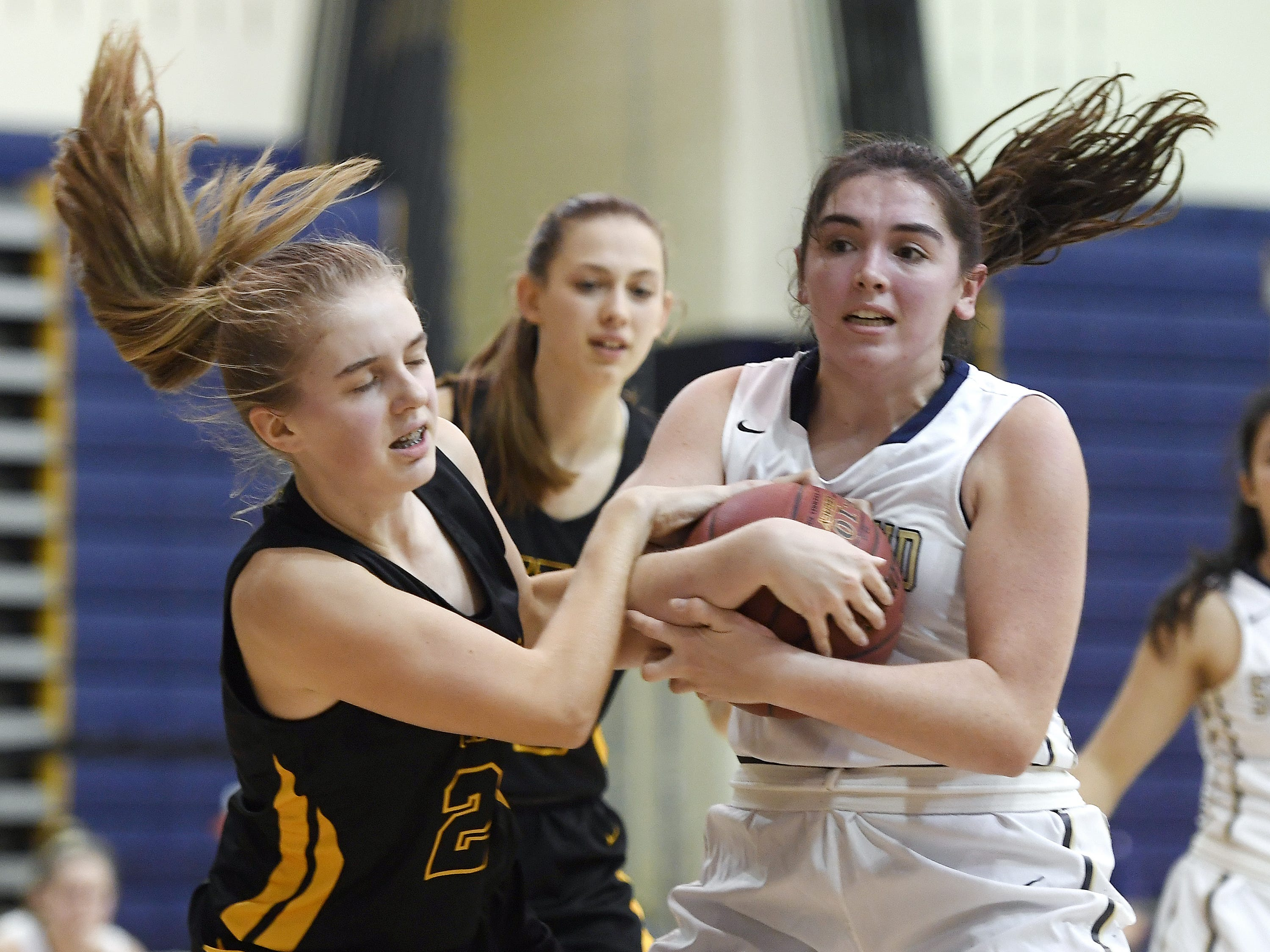 HF-L's Teagan Kamm, left, ties the ball up with Pittsford Sutherland's Libby Kenneally during a regular season game played at Pittsford Sutherland High School on Thursday, Nov. 29, 2018. Pittsford Sutherland beat Honeoye Falls-Lima in overtime 53-47.