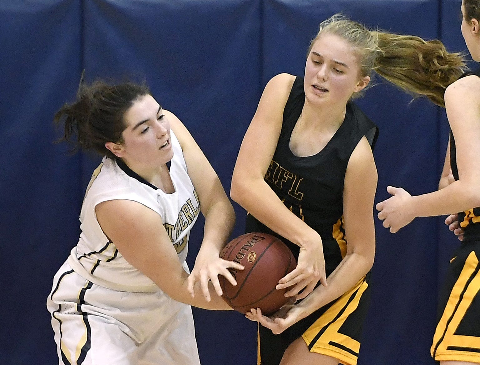 Pittsford Sutherland's Libby Kenneally, left, fights for possession against HF-L's Teagan Kamm during a regular season game played at Pittsford Sutherland High School on Thursday, Nov. 29, 2018. Pittsford Sutherland beat Honeoye Falls-Lima in overtime 53-47.