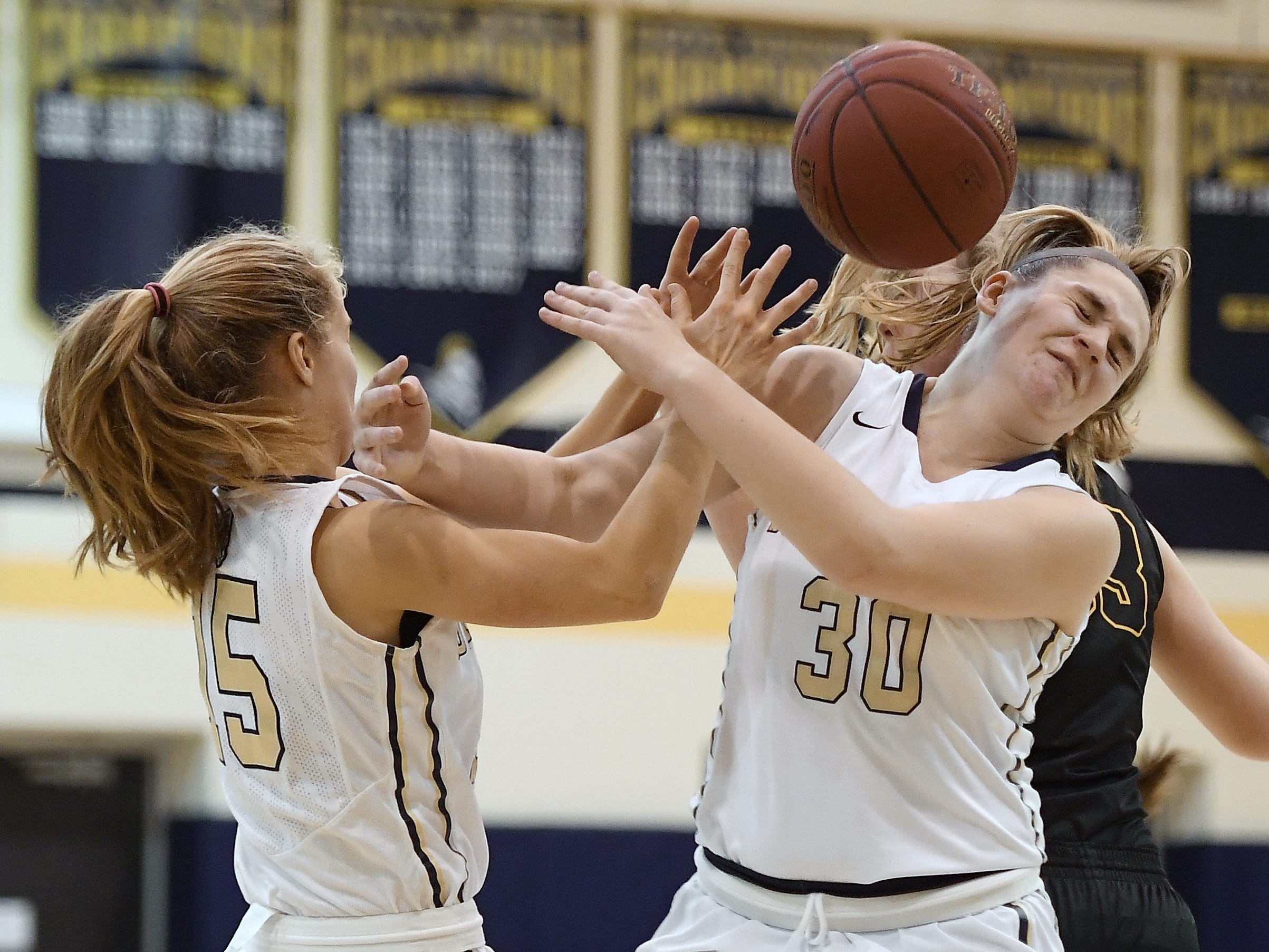 Pittsford Sutherland's Aneliese Brandt, right, reaches for a rebound with teammate Erika Newcomb during a regular season game played at Pittsford Sutherland High School on Thursday, Nov. 29, 2018. Pittsford Sutherland beat Honeoye Falls-Lima in overtime 53-47.