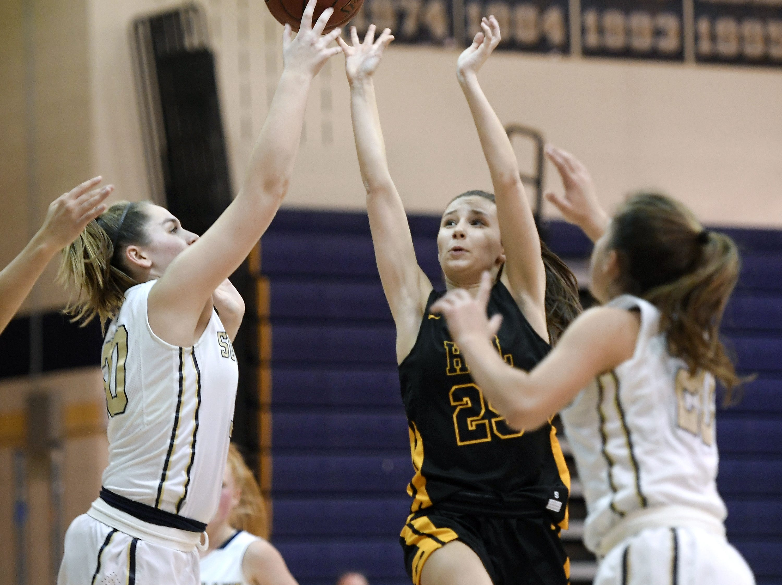 HF-L's Katie Brown, right, takes a shot while defended by Pittsford Sutherland's Aneliese Brandt during a regular season game played at Pittsford Sutherland High School on  Thursday, Nov. 29, 2018. Pittsford Sutherland beat Honeoye Falls-Lima in overtime 53-47.